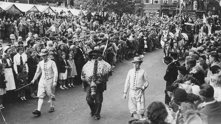 Snap the dragon and the Whifflers clearing the way for the festival celebrations in 1951