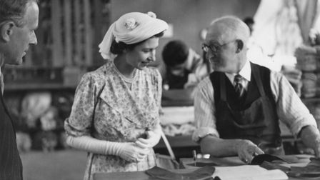 Princess Elizabeth chatting to one of the clickers (leather cutters) at Edwards & Holmes Ltd's facto