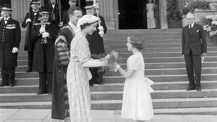 ROYAL FAMILYPrincess Elizabeth (Queen Elizabeth) receiving bouquet of flowers from young girl. Lor
