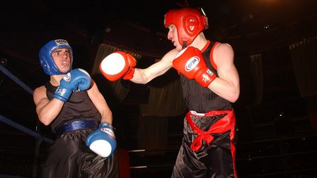 Ryan Walsh (red ) in action against Paul Edwards during the National ABA quarter finals boxing matc