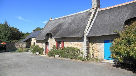 Thatched cottages in Brittany france (c) kbwills - Getty Images