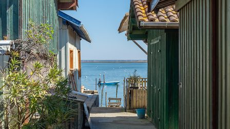 A view of Bird Island between fishermen's houses (c) Eric Cowez/Getty Images