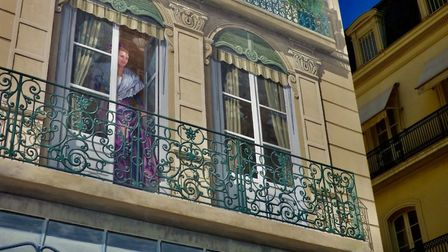 Marie Caufoppe peers down from her balcony in Beziers. Pic: Stephen Turnbull