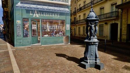 L'Arlesienne cafe depicted in a mural. Pic: Stephen Turnbull