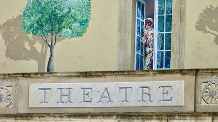 A woman peeks out above a theatre. Pic: Stephen Turnbull