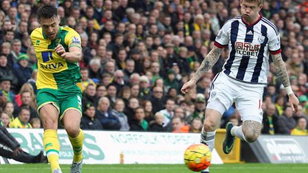 Russell Martin of Norwich and James McClean of West Bromwich Albion in action during the Barclays Pr