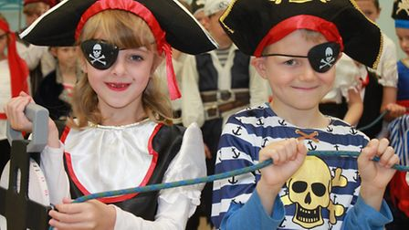 Seven-year-old pupils Olivia Toyn and Alfie Hollan-Penegelly dressed in swashbuckling gear for a pir