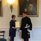 Amelia Raby receiving her award from Norfolk's High Sheriff Michael Gurney.