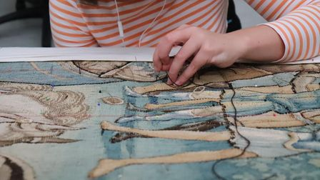 A National Trust conservator at work at the National Trust's Textile Conservation Studio.The tapest