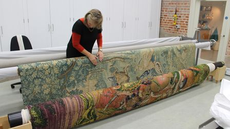 Framing the tapestry ready for conservation work at the National Trust's Textile Conservation Studio