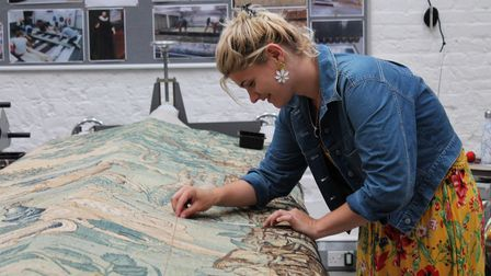A National Trust conservator at work at the National Trust's Textile Conservation Studio
