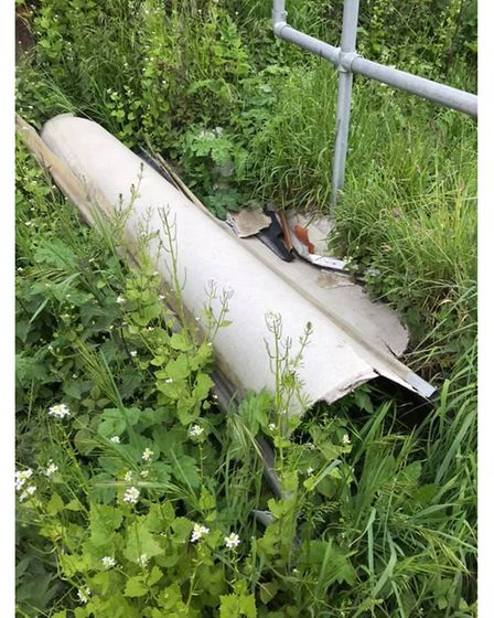 A large piece of metal left in the verge next to the bridge