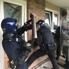 Norfolk police raiding a property suspected of dealing drugs in Heathgate, Norwich as part of Operat