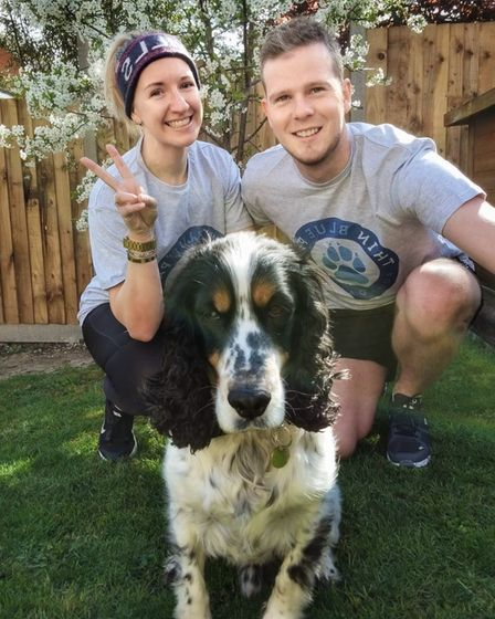 Carly and George Laflin with their dog Pablo after he had life-changing surgery on his abdomen