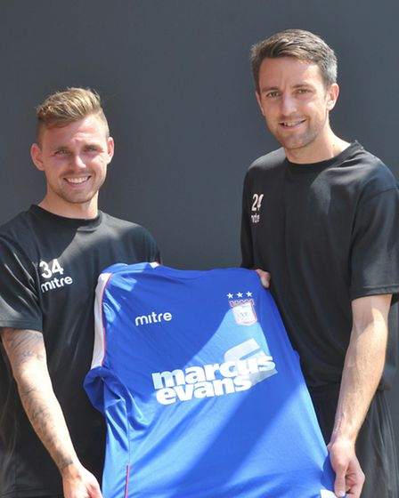 Cole Skuse, pictured on his first day as an Ipswich Town player alongside fellow signing Paul Anderson