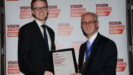 George Anderson being presented with awards by professor Richard Folkson, president of the Instituti