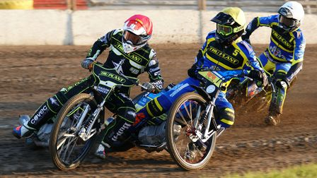 Witches number one Jason Crump leads the way in the opening heat, from Adam Ellis and Troy Batchelor