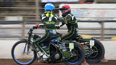 Danny King and Anders Rowe congratulate each other after their 5-1 maximum in heat 11.
