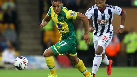 Elliott Bennett of Norwich and Serge Gnabry of West Bromwich Albion in action during the Capital One