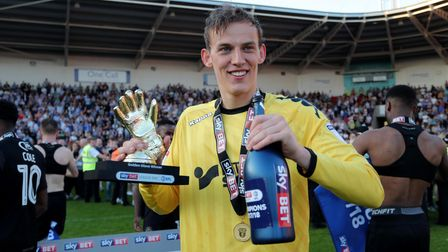 Wigan's Richard Christian Walton celebrates after Wigan win the sky Bet League One league at at the
