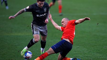 Sheffield Wednesday's Josh Windass (left) and Luton Town's Kal Naismith battle for the ball during t