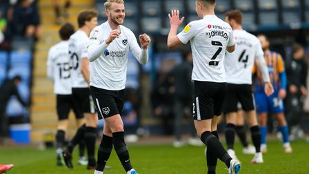 Portsmouth's Jack Whatmough and team mate Callum Johnson celebrate at the end of the Sky Bet League