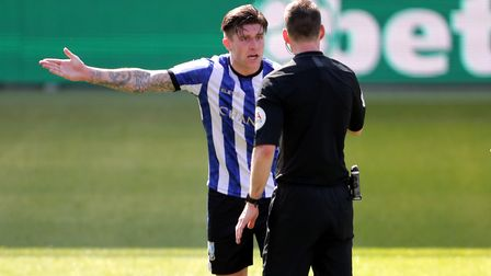 Sheffield Wednesday's Josh Windass speak to referee Jarred Gillett as he appeals for a penalty durin