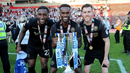 Wigan's Cheyenne Dunkley,Wigan's Gavin Massey and Wigan's Callum Elder celebrate after wining the le