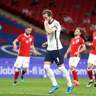England's Harry Kane celebrates scoring their side's first goal of the game during the 2022 FIFA Wor