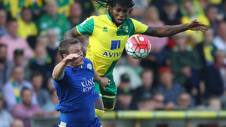 Dieumerci Mbokani of Norwich and Robert Huth of Leicester City in action during the Barclays Premier