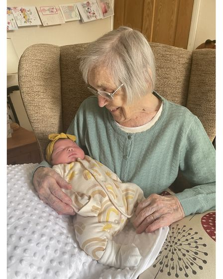 A tender moment for great-great-grandmother Edith Stannard, aged 103, and baby Rayn Rose