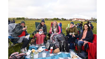 A group enjoying the atmosphere at the outdoor screening of Yesterday in Southwold