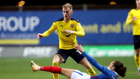 Oxford United's Mark Sykes (left) and Portsmouth's Marcus Harness battle for the ball during the Sky