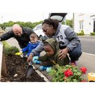 The planting at Marham Park in Bury St Edmunds with Little Acorns Childcare to mark National Children's Gardening Week