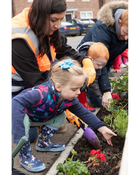 Annette Hurst helping the children from Little Acorns Childcare with the planting at Marham Park in Bury St Edmunds