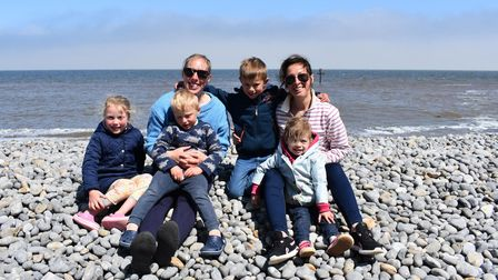 (L-R) Jess, William and Emily Naylor and Austin, Rebecca and Amelie Seymour enjoying the sun on Sheringham beach