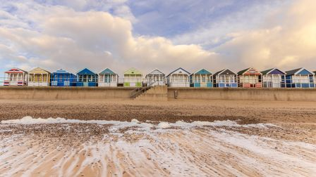 Colourful beach huts on the seafront in Southwold