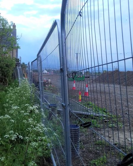 Fencing separating homes nearby at Soham station