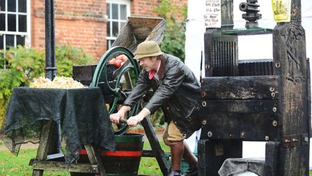 Stephen Fisher making cider on Apple Day at Gressenhall Farm & Workhouse. Picture: Ian Burt