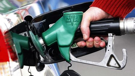 File photo dated 22/04/08 of a person using a petrol pump. PRESS ASSOCIATION Photo. Issue date: Tues