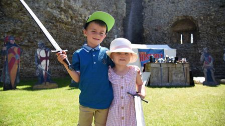 Brother and sister Charlie and Holly learn how to sword fight. Framlingham Castle half term fun day