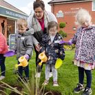 The children from Happyfeet Nursery in Watton with their watering cans.