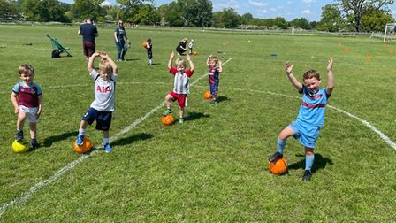 """During 'Kicking Cubs"""" Scott creates fun games incorporating the grass root pitch markings."""