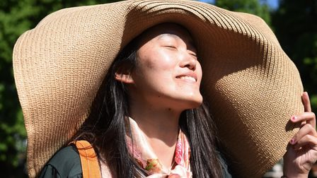 Yin Yin Lu enjoying the sunny warm weather at Chapelfield Gardens with an enormous sun hat. Picture