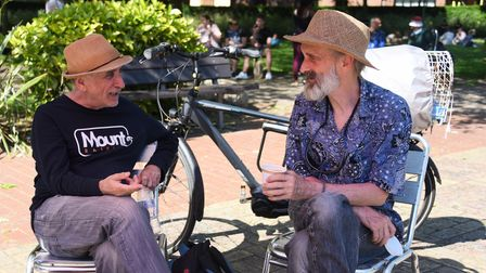 A chat and a drink for Pierre Ouzerdine, left, and Mouse Sperry, in the sunny warm weather at Chapel