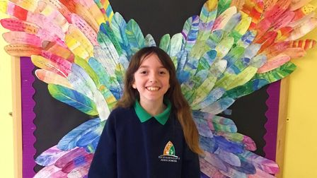 Year 4 pupil Amy with the rainbow wings at Ely St Mary's Church of England Junior School.