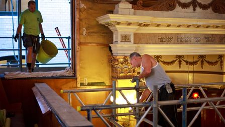 Workmen during roof repairs and renovations at Sandys Row