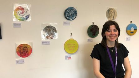 Fundraising assistant Ella Cairns with donated artworks fromthe Circular Art Fair
