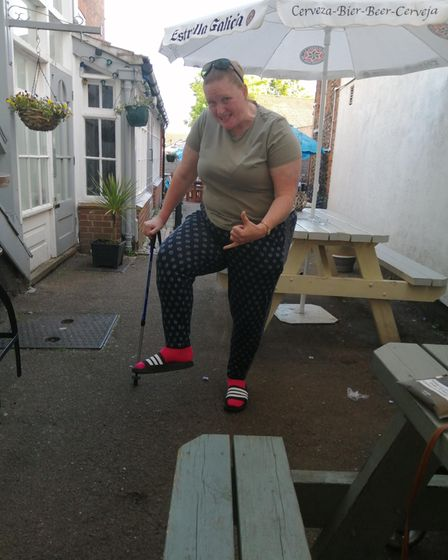 Abbie Moyse back at The Crown in Fakenham after completing the walk.