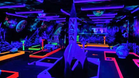 The neon space adventure that you'll find insideGloGolf Peterborough.